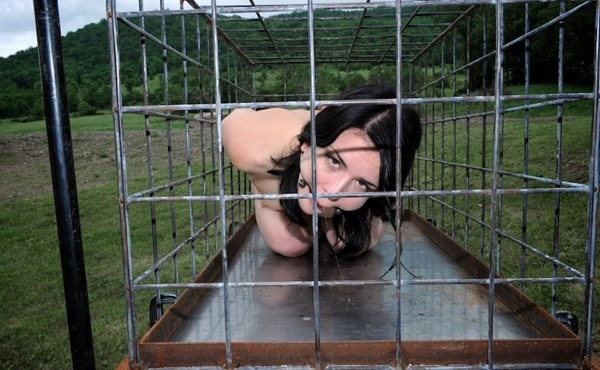 infernal-restraints-naughty-babe-locked-in-a-cage